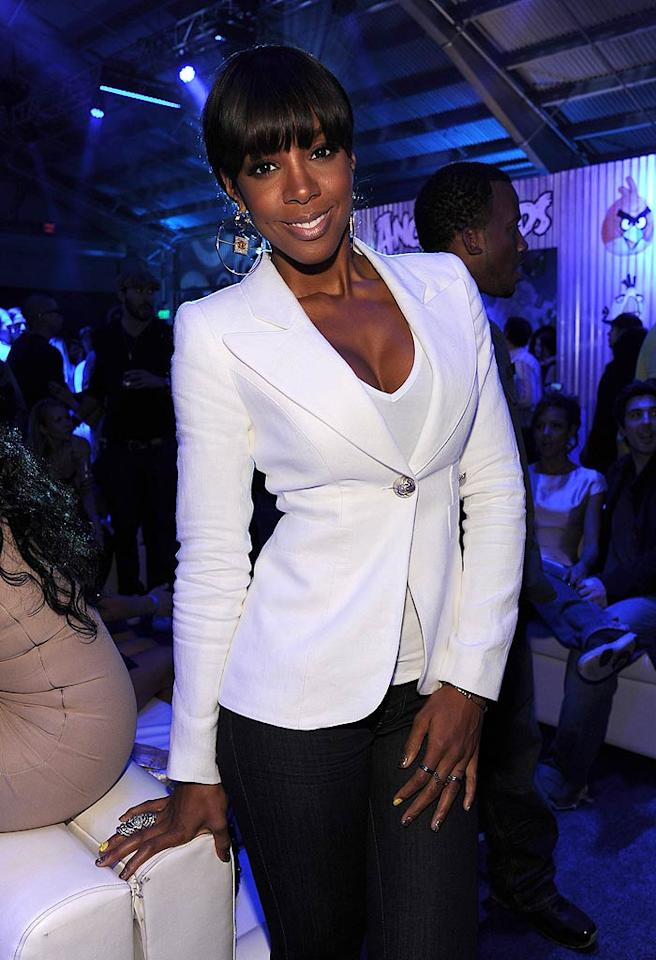 """Former Destiny's Child member Kelly Rowland showed off some serious cleavage in her tight white T-shirt and blazer. Looking good! Sciulli/<a href=""""http://www.wireimage.com"""" target=""""new"""">WireImage.com</a> - May 12, 2011"""
