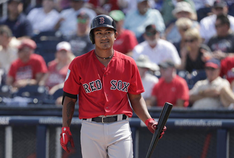 Boston Red Sox's Tzu-Wei Lin smiles at home plate during the first inning of an exhibition spring training baseball game against the Washington Nationals, Tuesday, March 5, 2019, in West Palm Beach. (AP Photo/Brynn Anderson)