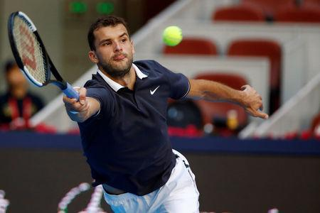 Tennis - China Open - Men's Singles - Second Round - National Tennis Center, Beijing, China - October 3, 2018. Grigor Dimitrov of Bulgaria in action against Dusan Lajovic of Serbia. REUTERS/Thomas Peter