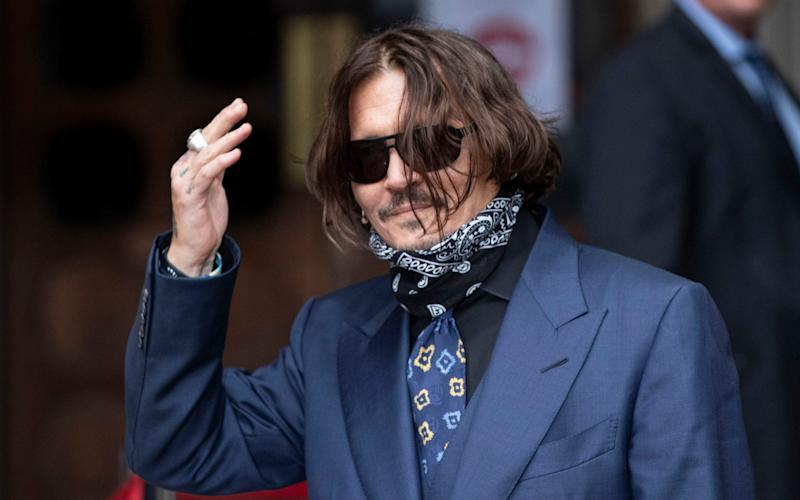"""Johnny Depp arriving at the High Court in London for his libel case against the publisher of The Sun newspaper News Group Newspapers for labelling him a """"wife beater"""" - Heathcliff O'Malley"""