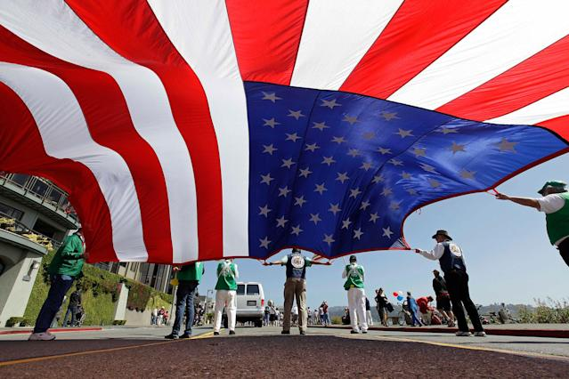 <p>Members of the Native Sons of the Golden West carry a large American flag during the annual Fourth of July Parade Wednesday, July 4, 2012 in Sausalito, Calif. The group was founded in 1875 and has preserved many of the landmarks of California's pioneer days, purchasing and rehabilitating them and then donating them to the State or local governments. (Photo: Eric Risberg/AP) </p>