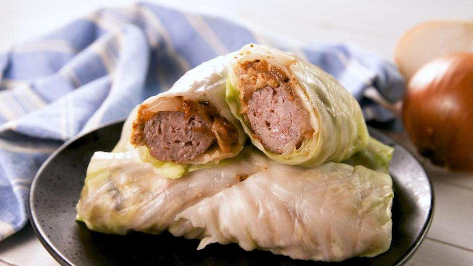 """<p>Caramelized onions make everything better.</p><p>Get the recipe from <a href=""""https://www.delish.com/cooking/recipe-ideas/a27483720/cabbage-wrap-brats-recipe/"""" rel=""""nofollow noopener"""" target=""""_blank"""" data-ylk=""""slk:Delish"""" class=""""link rapid-noclick-resp"""">Delish</a>.</p>"""