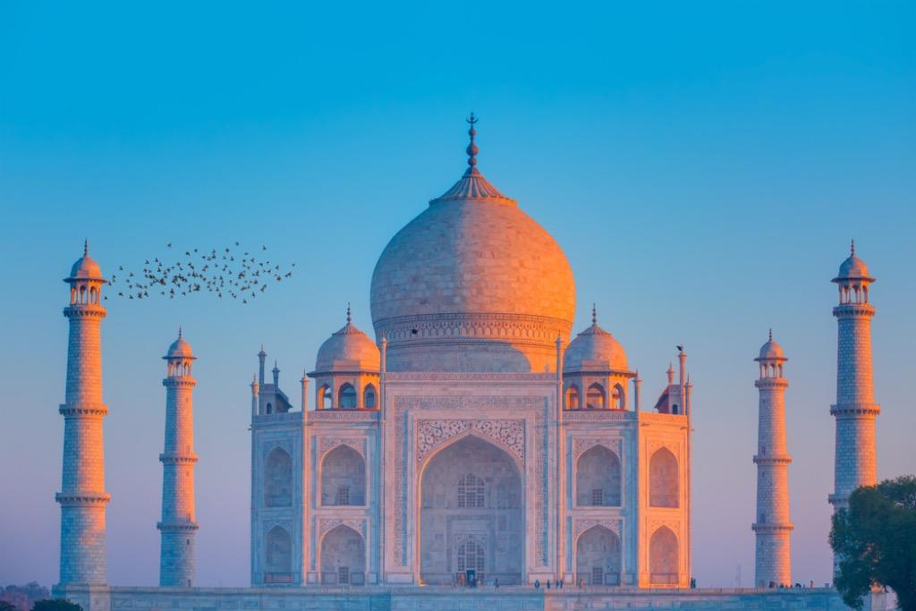 "According to <a href=""https://www.cnn.com/travel/article/places-to-avoid-2018/index.html"" target=""_blank"">CNN</a>, visiting Taj Mahal is only a good idea if you enjoy contending with thousands of other tourists elbowing you to get the best Instagram picture of its beautiful architecture. In fact, this location proves to be one of the <a href=""https://bestlifeonline.com/overrated-tourist-attractions/?utm_source=yahoo-news&utm_medium=feed&utm_campaign=yahoo-feed"" target=""_blank"">most popular tourist destinations</a> in the entire world, with around eight million visitors crowding around its exterior every year. So, if your heart is still set on seeing this historic place, plan to arrive there at dawn, before the crush of the crowds."