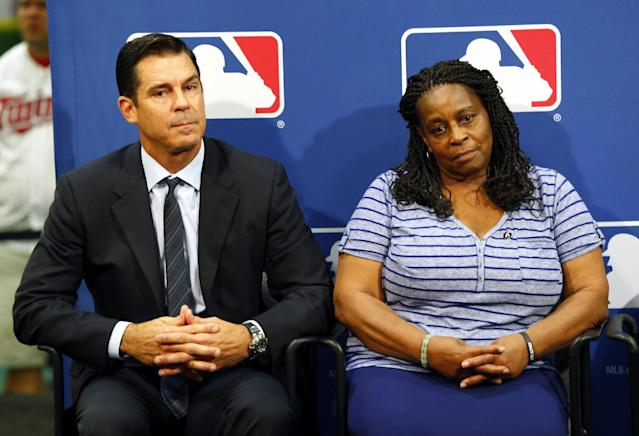 Former major league outfielder Billy Bean, left, and Lutha Burke look on during a news conference at baseball's All-Star game, Tuesday, July 15, 2014, in Minneapolis. Major League Baseball has appointed Bean, who came out as gay after his playing career, to serve as a consultant in guiding the sport toward greater inclusion and equality. Burke is the sister of Glenn Burke, who was the first MLB player to come out as gay after retiring. Burke died in 1995. (AP Photo/Paul Sancya)