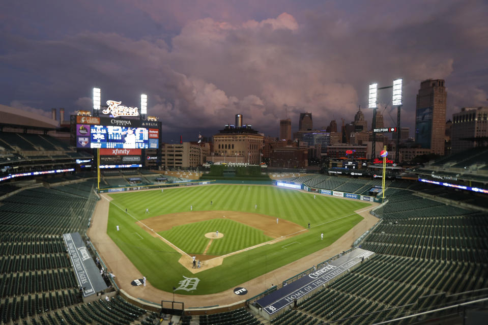 The sun sets as the Detroit Tigers and the Kansas City Royals play a baseball game Monday, July 27, 2020, in Detroit. (AP Photo/Carlos Osorio)