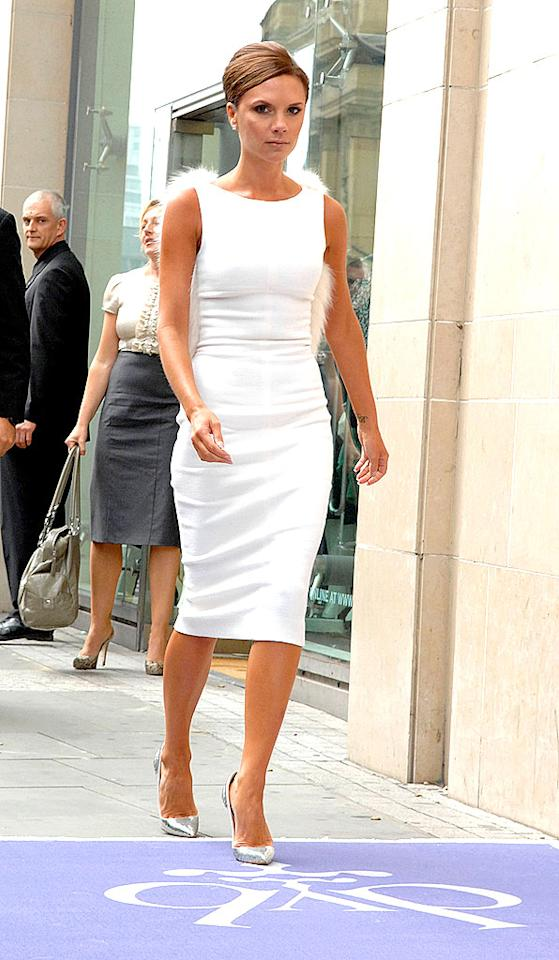 "You'd never know Victoria Beckham was a mom of three in her sleek white frock. Shirlaine Forrest/<a href=""http://www.wireimage.com"" target=""new"">WireImage.com</a> - August 29, 2008"