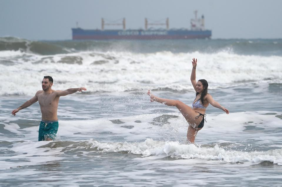 Ollie King, 22, and his sister Laura, 19, take a dip into the sea at King Edward's Bay in Tynemouth (Owen Humphreys/PA)