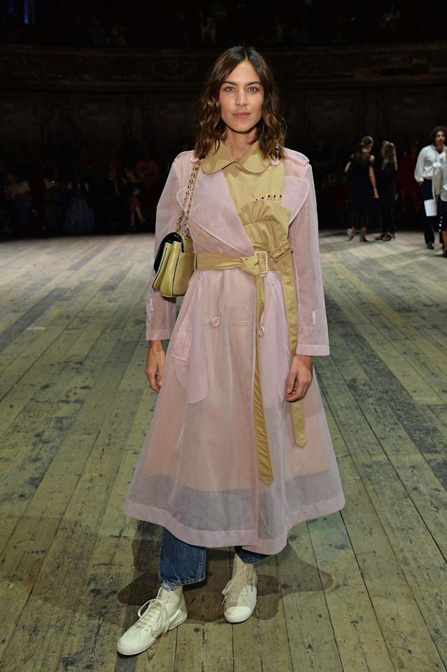 <p>The model-turned designer rocked a pair of jeans, white trainers and a sheer pink and beige-coloured trench coat to the Simone Rocha show. </p>