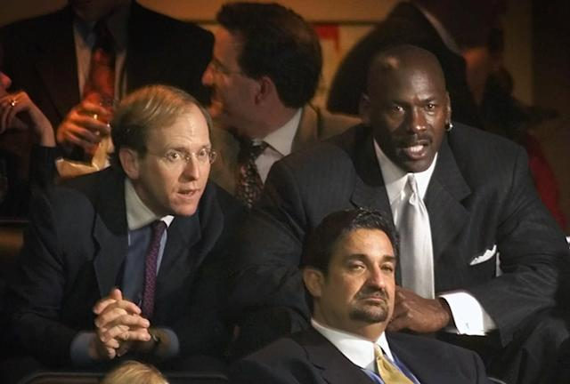 """FILE - In this Jan. 19, 2000, file photo, former Chicago Bulls great Michael Jordan, rear right, sits in the owner's sky box with Washington Capitals minority owner Jon Ledecky, left, and Washington Wizards minority owner Ted Leonsis, front, during an NBA game at the MCI Center in Washington. The Islanders have announced that the team is being sold to a former Washington Capitals co-owner and a London-based investor. In a statement Tuesday, Aug. 19, 2014, the team says a group led by former Capitals co-owner Jon Ledecky and investor Scott Malkin has reached an agreement to buy a """"substantial"""" minority interest in the team. (AP Photo/Pablo Martinez Monsivais. File)"""