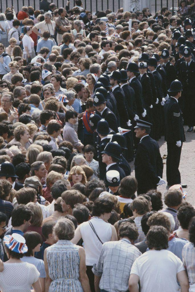 <p>Police were out in full force to manage the massive crowds along the procession route. Wouldn't you fight your way through to catch a glimpse at the newlyweds? </p>