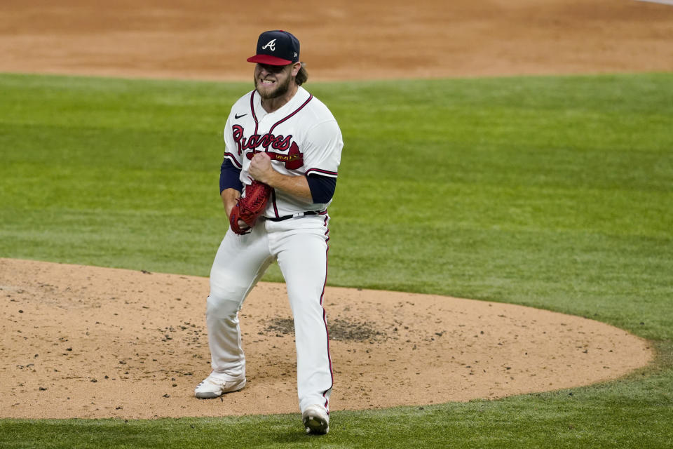 Atlanta Braves relief pitcher A.J. Minter celebrates after striking out Los Angeles Dodgers' Mookie Betts during the third inning in Game 5 of a baseball National League Championship Series Friday, Oct. 16, 2020, in Arlington, Texas. (AP Photo/Tony Gutierrez)