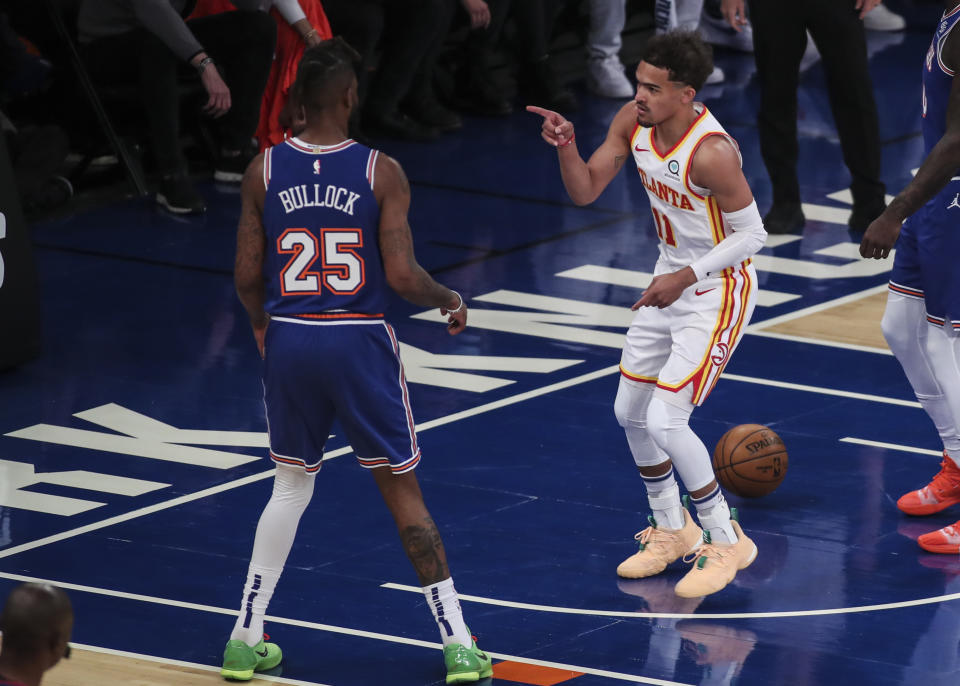 NEW YORK, NY - JUNE 02:  Trae Young #11 of the Atlanta Hawks points at Reggie Bullock #25 of the New York Knicks after scoring in the first quarter during Game Five of the Eastern Conference first round series at Madison Square Garden on June 02, 2021 in New York City. NOTE TO USER: User expressly acknowledges and agrees that, by downloading and or using this photograph, User is consenting to the terms and conditions of the Getty Images License Agreement.  (Photo by Wendell Cruz-Pool/Getty Images)