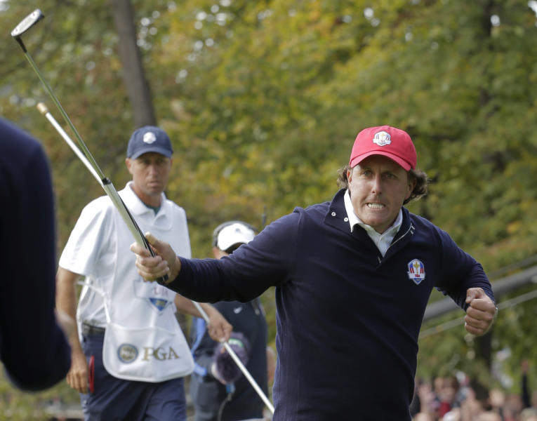 USA's Phil Mickelson reacts after making a putt to win the 13th hole during a foresomes match at the Ryder Cup PGA golf tournament Friday, Sept. 28, 2012, at the Medinah Country Club in Medinah, Ill. (AP Photo/Charlie Riedel)