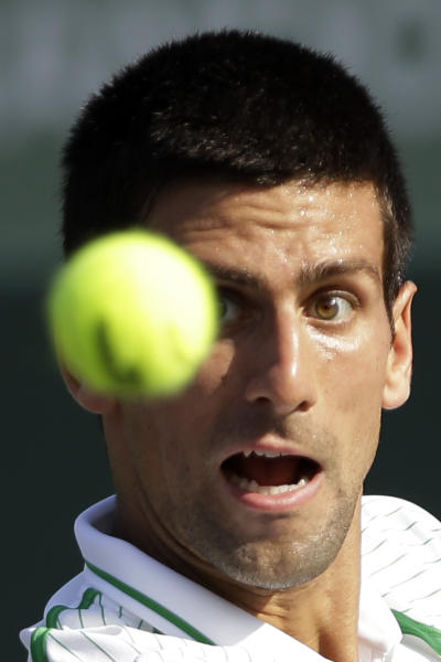 Novak Djokovic, of Serbia, looks to return to Somdev Devvarman, of India, during the Sony Open tennis tournament in Key Biscayne, Fla., Sunday, March 24, 2013. (AP Photo/Alan Diaz)