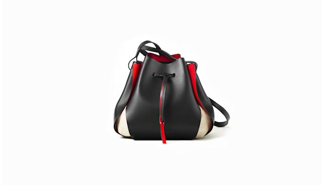 "<p>The Tulip Bag, $425, <a href=""https://www.linjer.co/collections/women-leather-bags/products/the-tulip-bag-black-red?variant=40103980237"" rel=""nofollow noopener"" target=""_blank"" data-ylk=""slk:linjer.co"" class=""link rapid-noclick-resp"">linjer.co</a> </p>"