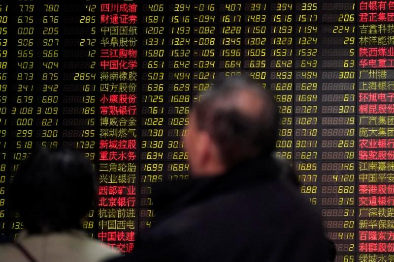 Investors look at an electronic board showing stock information at a brokerage house in Shanghai, China February 9, 2018. REUTERS/Aly Song