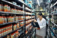 An employee checks on packaged drugs stored in the Stability Chambers of Himalaya Drug Company, in Bangalore, on February 14, 2013. Himalaya's sales have quadrupled in the last five years to reach $220 million in 2012. Its target is a billion dollars in annual revenue in the next four years as it spreads into foreign markets