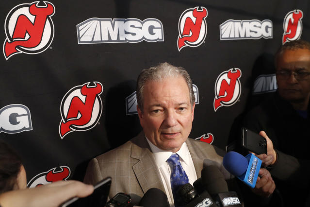 New Jersey Devils General Manager Ray Shero speaks to members of the media before an NHL hockey game against the Vegas Golden Knights, Tuesday, Dec. 3, 2019, in Newark, N.J. The Devils fired head coach John Hynes earlier Tuesday and named Alain Nasreddine interim head coach. (AP Photo/Kathy Willens)