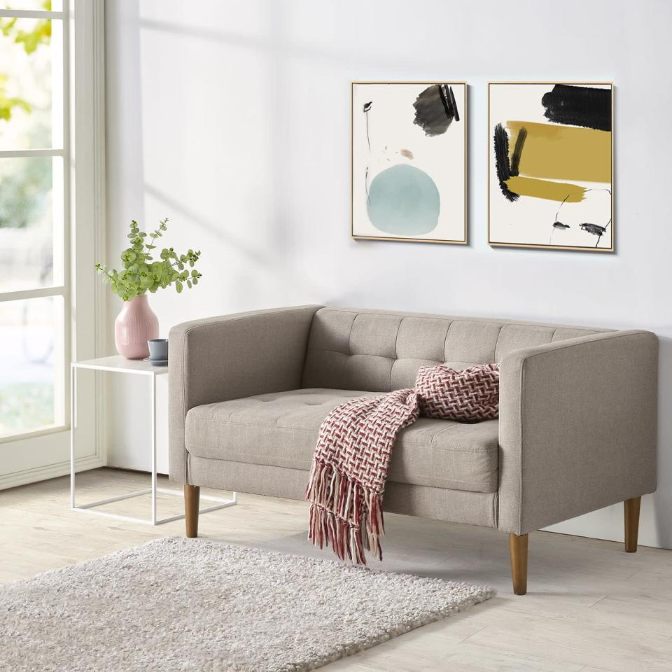<p>This <span>Woven Paths Loveseat</span> ($349) belongs in your minimalist-themed living room.</p>