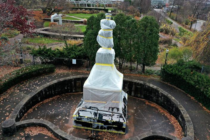 A statue of Christopher Columbus in the Oakland neighborhood of Pittsburgh, which was wrapped to protect it from vandalism ahead of Columbus Day in October, remained in a protective covering on Thanksgiving Day.