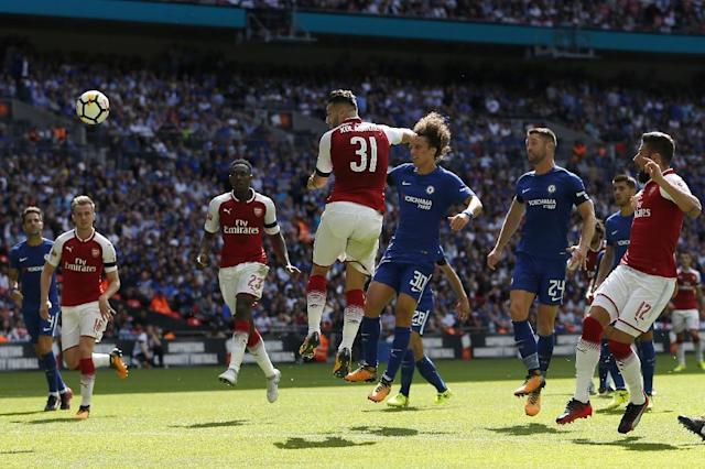 Arsenal's defender Sead Kolasinac (C) scores during the English FA Community Shield football match against Chelsea at Wembley Stadium in north London on August 6, 2017 (AFP Photo/Ian KINGTON)