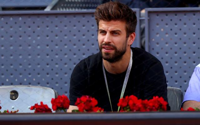 Barcelona footballer Gerard Pique watching the Madrid Open on Monday - Getty Images Europe