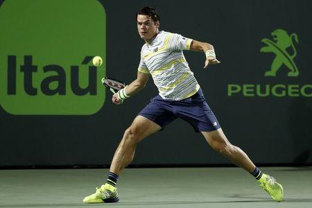 Mar 28, 2018; Key Biscayne, FL, USA; Milos Raonic of Canada hits a forehand against Juan Martin del Potro of Argentina (not pictured) on day nine at the Miami Open at Tennis Center at Crandon Park. Mandatory Credit: Geoff Burke-USA TODAY Sports