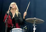 """<div class=""""caption-credit""""> Photo by: Getty Images</div><div class=""""caption-title"""">Performing at the V Festival in 2011</div>It takes a bold, confident woman to tackle singing and drumming at the same time. It takes an even bolder, more confident woman to wear a two-toned fringed jacket."""
