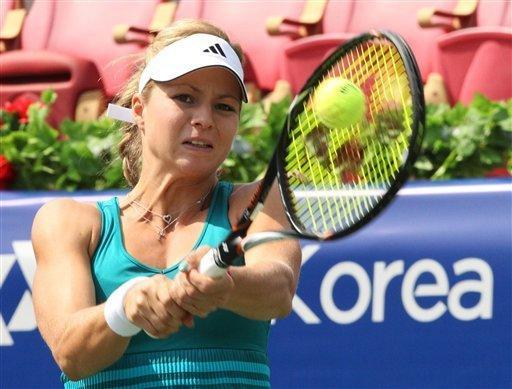 Maria Kirilenko of Russia returns a shot against Lee So-ra of South Korea during the first round match at Korea Open Tennis Championships in Seoul, Wednesday, Sept. 19, 2012. Kirilenko retired from the match, after the 1-1 in the first set, due to an injury. (AP Photo/Ahn Young-joon)