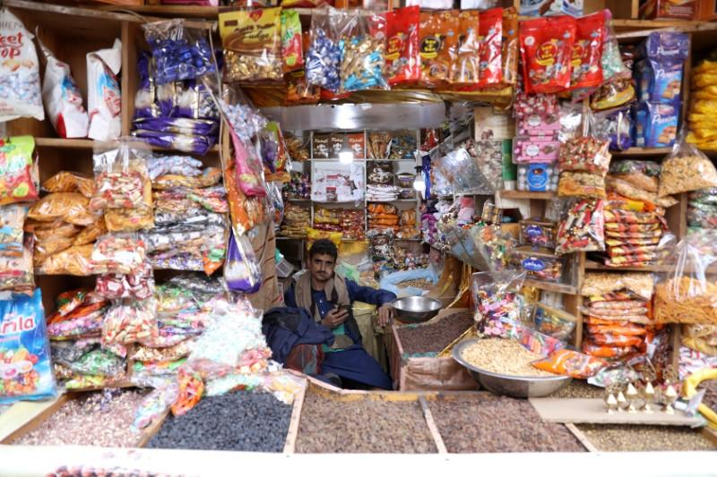 Sweets vendor waits for customers at his shop at the old quarter of Sanaa