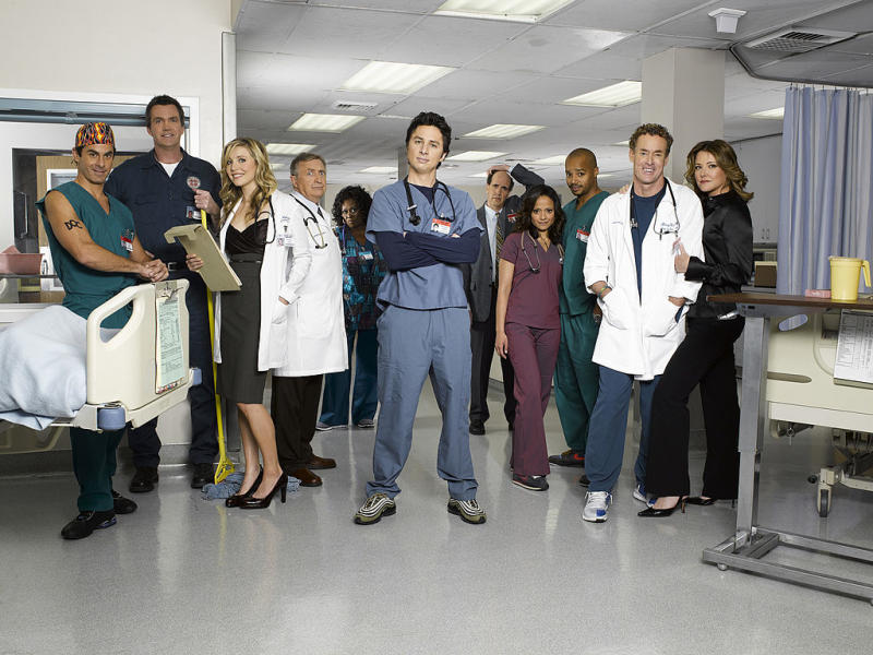 The cast of popular TV show Scrubs – including Zach (centre) Braff, Sarah Chalke (third from left) and Donald Faison (third from right) – with Lloyd (fifth from right). Source: Getty Images