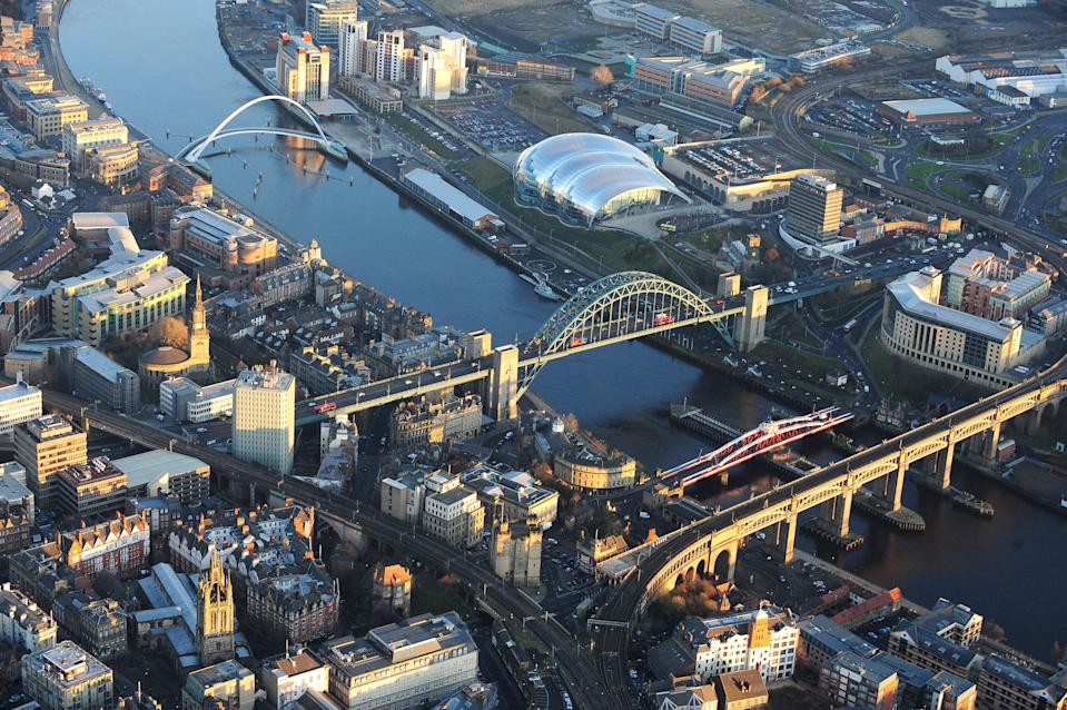 Aerial view of Newcastle city centre showing the Tyne Bridge, the Gateshead Millennium Bridge (also know as the 'Blinking Eye Bridge'), The Baltic Arts Centre and the Sage Gateshead music centre.