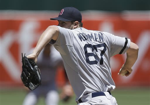 Boston Red Sox's Brandon Workman pitches against the Oakland Athletics in the first inning of a baseball game Sunday, July 14, 2013, in Oakland, Calif. (AP Photo/Ben Margot)
