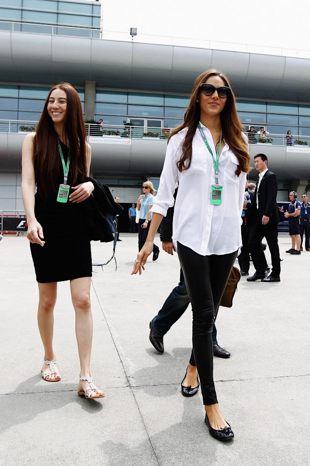 SHANGHAI, CHINA - APRIL 15: Jessica Michibata (R), girlfriend of Jenson Button of Great Britain and McLaren arrives in the paddock with her younger sister Angelica Michibata (L) before the Chinese Formula One Grand Prix at the Shanghai International Circuit on April 15, 2012 in Shanghai, China. (Photo by Paul Gilham/Getty Images)