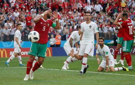 Soccer Football - World Cup - Group B - Portugal vs Morocco - Luzhniki Stadium, Moscow, Russia - June 20, 2018 Morocco's Medhi Benatia and Younes Belhanda reacts after missing a chance to score REUTERS/Maxim Shemetov