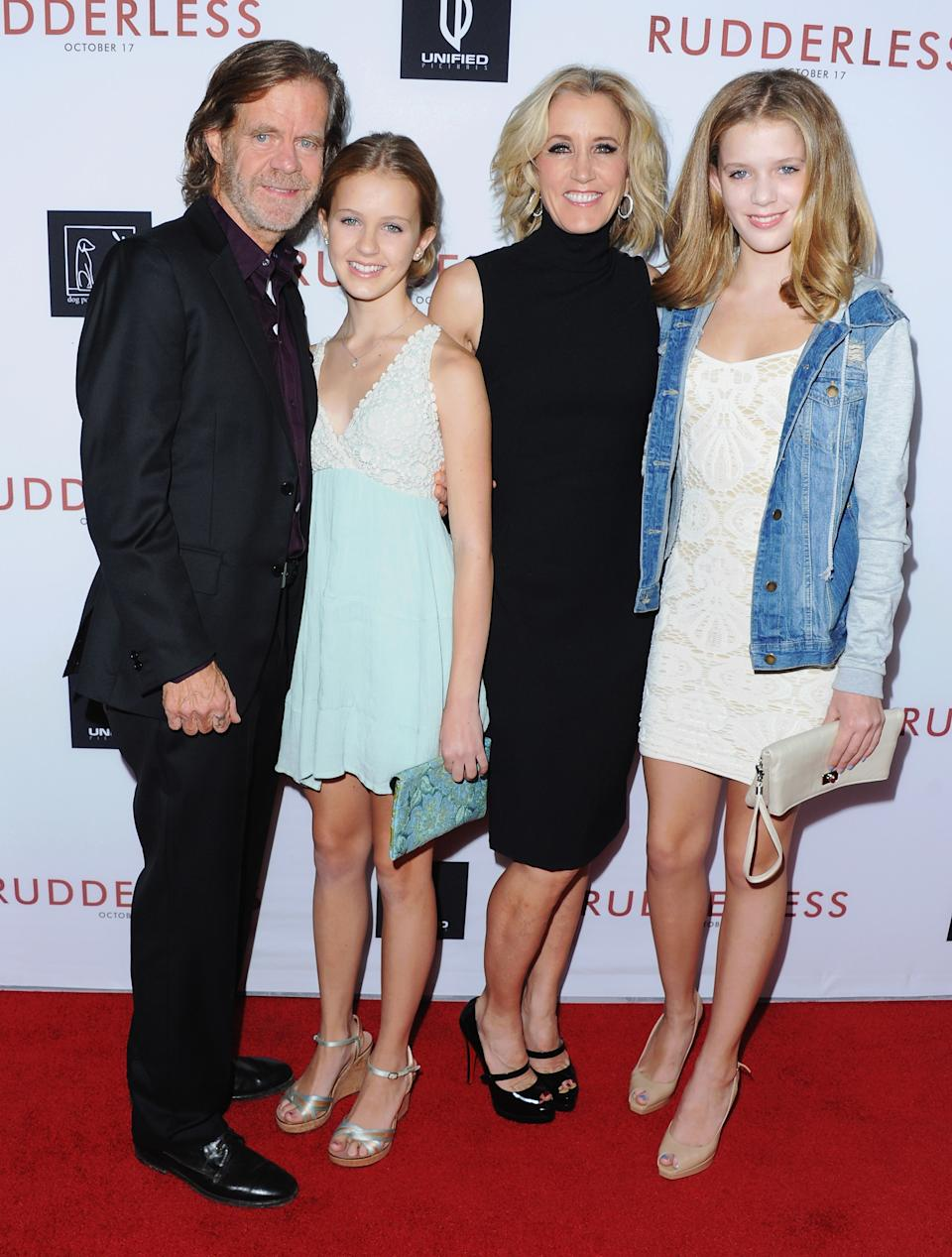 """LOS ANGELES, CA - OCTOBER 07:  Director/actor William H. Macy, daughter Georgia Macy, Actress Felicity Huffman and daughter Sofia Macy arrive at the Los Angeles VIP Screening """"Rudderless"""" at the Vista Theatre on October 7, 2014 in Los Angeles, California.  (Photo by Jon Kopaloff/FilmMagic)"""
