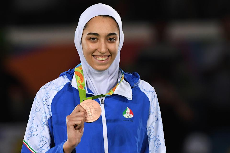 Iran's Kimia Alizadeh Zenoorin poses with her bronze medal on the podium after the womens taekwondo event in the -57kg category as part of the Rio 2016 Olympic Games. / Credit: KIRILL KUDRYAVTSEV/AFP via Getty Images