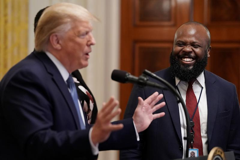 WASHINGTON, DC - OCTOBER 04: U.S. President Donald Trump introduces White House Deputy Director of the Office of American Innovation Ja'Ron Smith during an event for the Young Black Leadership Summit in the East Room of the White House October 04, 2019 in Washington, DC. Organized by the conservative nonprofit political group Turning Points USA, the summit bills itself as a professional development, leadership training and networking opportunity. (Photo by Chip Somodevilla/Getty Images)