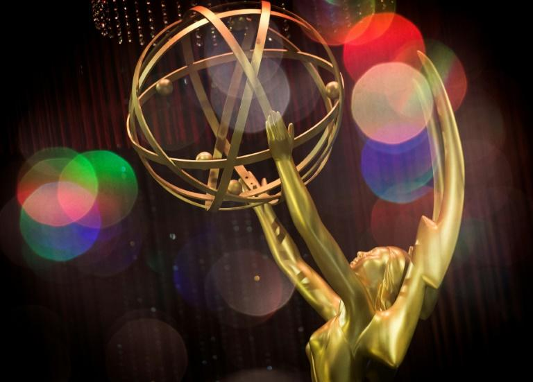 (FILES) This file double exposure photo taken on September 12, 2019 shows the Emmy Awards statue during the 71st Emmy Awards Governors Ball press preview in Los Angeles, California