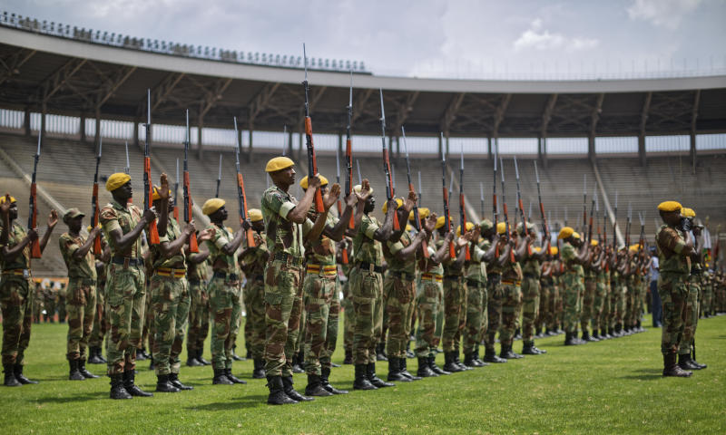 Zimbabwean military parade during a dress rehearsal ahead of Friday's presidential inauguration of Emmerson Mnangagwa, at the National Sports Stadium in Harare, Zimbabwe Thursday, Nov. 23, 2017. Zimbabwe on Thursday is making preparations to swear in a new leader after 37 years. (AP Photo/Ben Curtis)