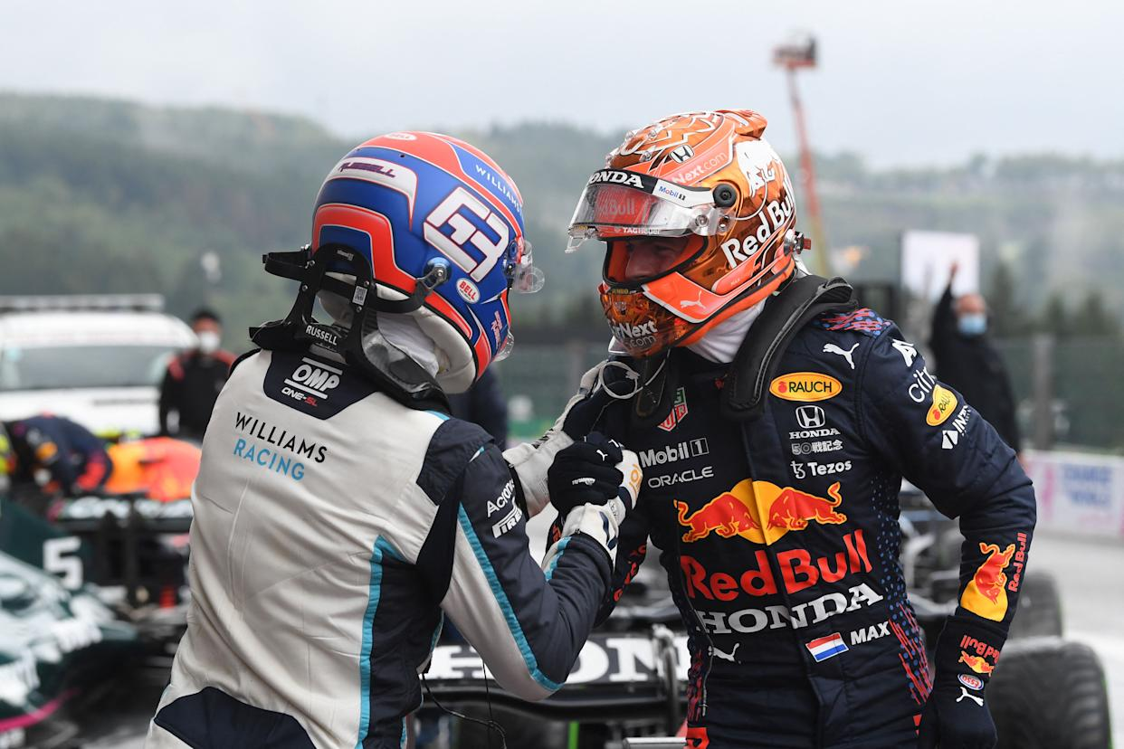 Red Bull driver Max Verstappen (R) celebrates with second-placed Williams' British driver George Russell.