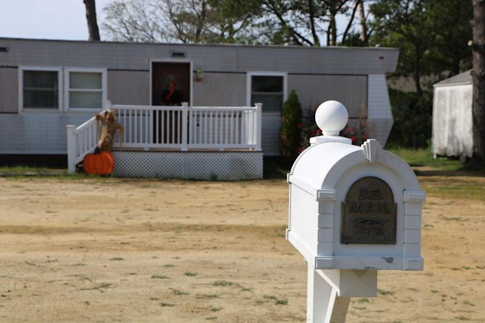 A white mailbox sits in front of a home in Ewell on Smith Island on Oct. 9, 2020. Residents are fighting to get the island's last remaining voting precinct reopened after officials closed it. Residents do have the choice to vote by mail, but many don't trust the option and prefer to vote in person.