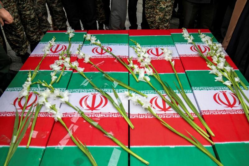 FILE PHOTO: The coffins of the four Iranian victims of the Ukrainian plane crash in Iran, are seen during their funeral ceremony in Hamadan