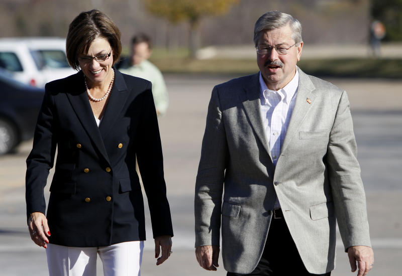 Iowa Republican gubernatorial candidate Terry Branstad arrives with his running mate Kim Reynolds, left, before a walk through at their election night rally, Tuesday, Nov. 2, 2010, in West Des Moines, Iowa. (AP Photo/Charlie Neibergall)