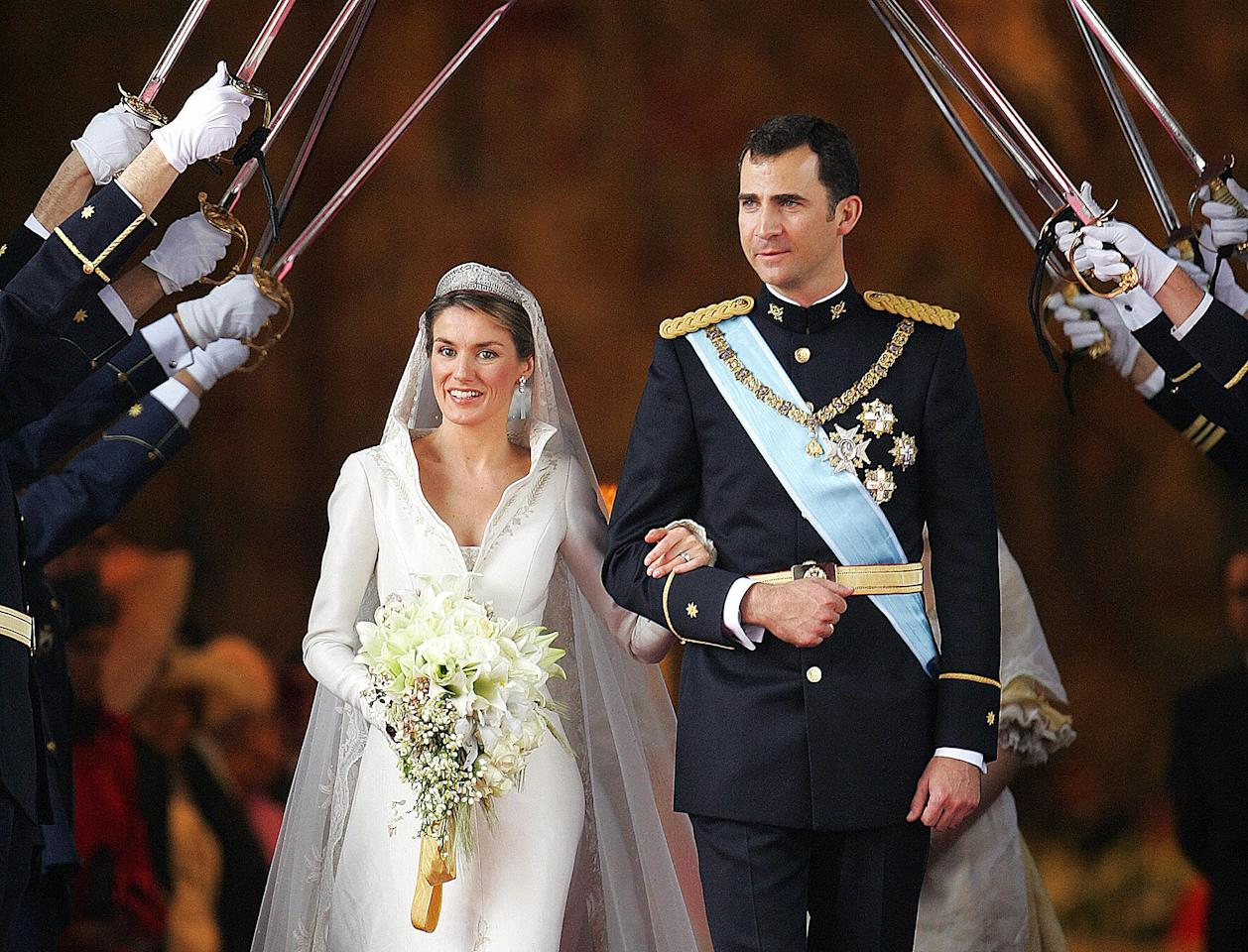 """King Felipe and <a rel=""""nofollow"""" href=""""https://people.com/tag/queen-letizia/"""">Queen Letizia</a> of Spain – then Crown Prince Felipe and Letizia Ortiz – were married on May 22, 2004, at Madrid's Almudena Cathedral."""