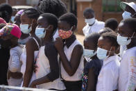 Children wear face masks while attending a social event in Epworth, Harare, in this Friday, June, 11, 2021 photo. Zimbabwe has opened up COVID-19 vaccination to the majority of teen children, while also allowing fully vaccinated people to eat in restaurants as a devastating third wave recedes and previously hesitant people take up jabs in higher numbers.(AP Photo/Tsvangirayi Mukwazhi)