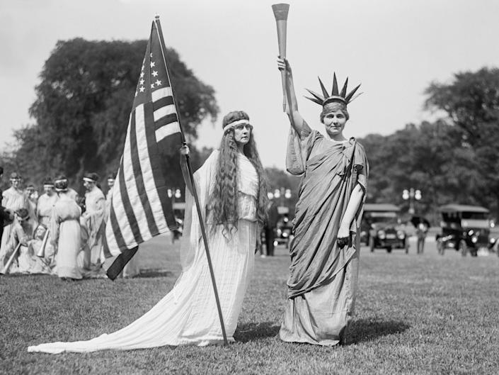 Women are dressed up in Washington, DC, on July 4, 1919, including a woman dressed as the Statue of Liberty.