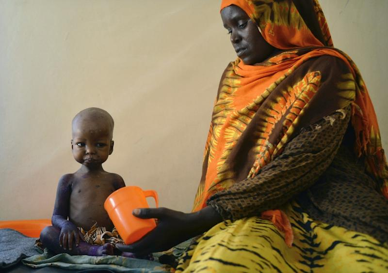 A malnourished child and her mother at a hospital in Baidoa, the capital of the Bay region of southwestern Somalia (AFP Photo/TONY KARUMBA)
