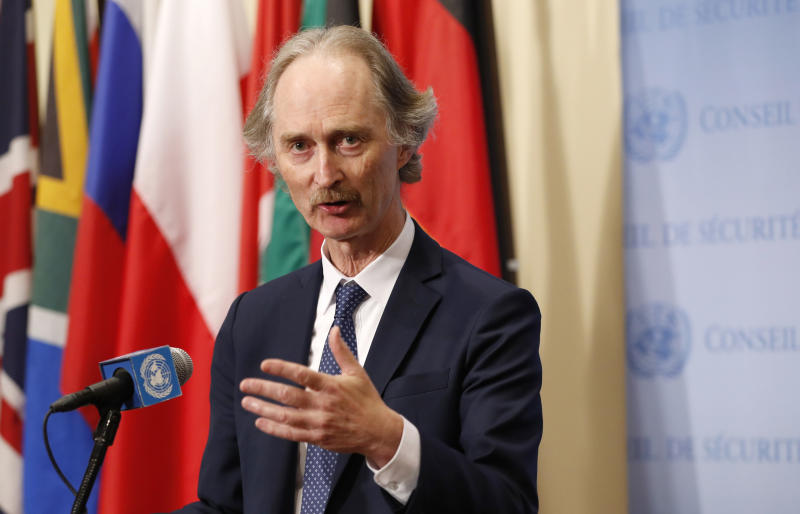 "FILE - In this April 30, 2019 file photo, U.N. Special Envoy for Syria Geir Pedersen speaks to journalists following a U.N. Security Council meeting on Syria at U.N. headquarter. Syria's state news agency SANA said Monday, Sept. 23, 2019, that the country's foreign minister discussed the formation of a constitutional committee and its work with U.N. special envoy Geir Pedersen. SANA said Walid al-Moallem's meeting with Pedersen on Monday focused on the committee's setup and guarantees that it be free ""from any foreign intervention."" (AP Photo/Kathy Willens, File)"