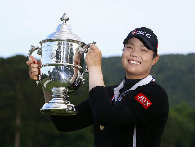 FILE - In this June 3, 2018, file photo, Ariya Jutanugarn, of Thailand, holds up the trophy after winning in a four hole playoff during the final round of the U.S. Women's Open golf tournament at Shoal Creek, in Birmingham, Ala. Jutanugarn is already the LPGA's player of the year and leading moneywinner this season. She'll look to cap the season with a win in the CME Group Tour Championship that begins Thursday, Nov. 15. (AP Photo/Butch Dill, File)